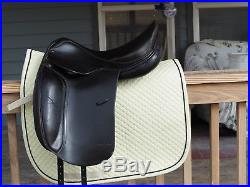 Black Dominus dressage saddle with leather girth, stirrups & stirrup leathers