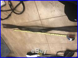 Dressage bridle and braided girth